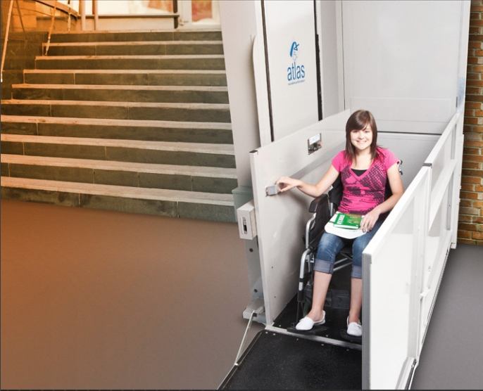 Wheelchair user operating a lift